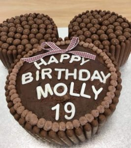 A chocolate birthday cake with the words